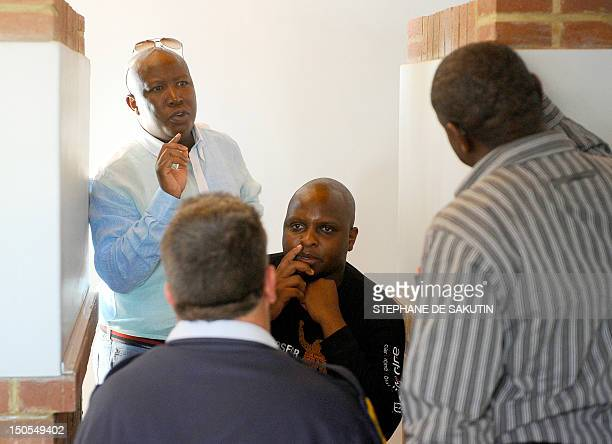 Expelled African National Congress Youth League president Julius Malema and former ANC Youth League spokesman Floyd Shivambu gesture at the Marikana...