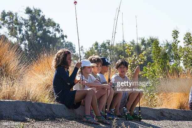 Experienced anglers kids and those wishing to learn to fish attend The first annual Off tha' Hook fly fishing event held on September 6 2014 on the...