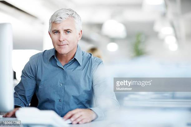 Experienced businessmansitting at his desk