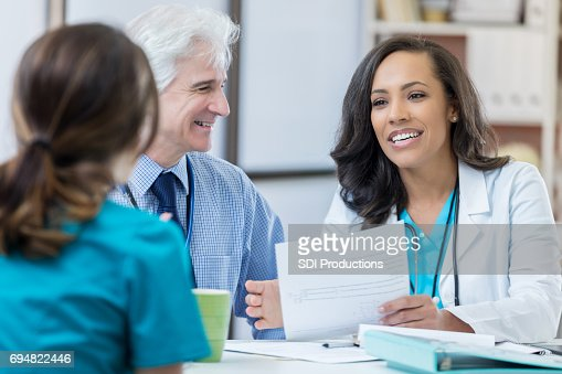 nurse presenting resume to hospital administrator during job