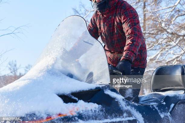 experienced driver on snowmobile - cliqueimages stock pictures, royalty-free photos & images