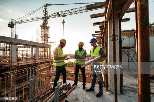 experienced engineer explaining the problems in construction works - construction material stock pictures, royalty-free photos & images