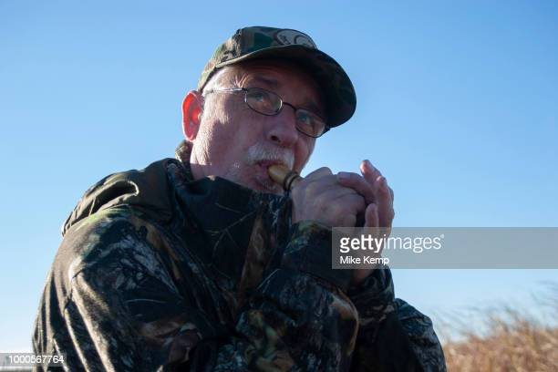 Experienced hunter Timmy Stein makes calls using one of his duck callers whilst duck hunting near Minot North Dakota United States Timmy has been...