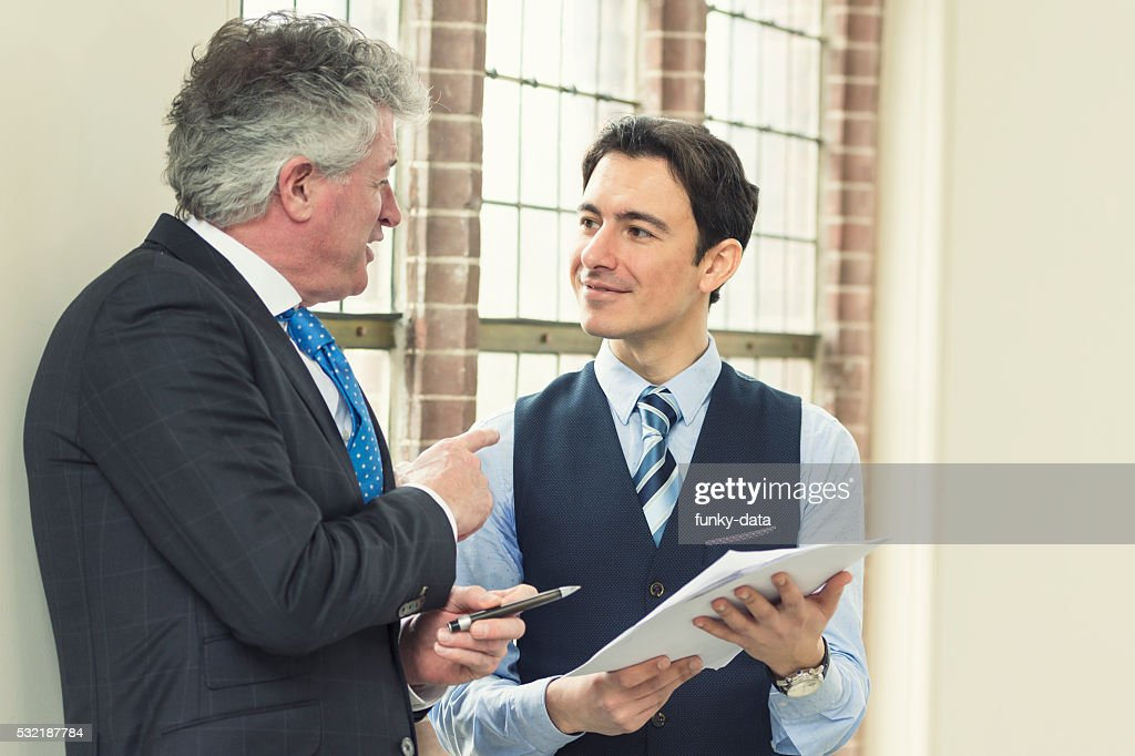 Experienced manager with young employee : Stock Photo