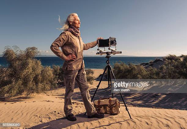 experienced photographer with large format camera. - photographer stock pictures, royalty-free photos & images