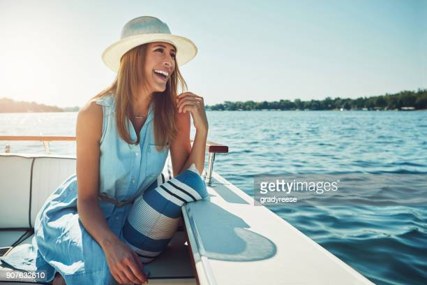 experiencing the open sea in luxury - beautiful woman stock pictures, royalty-free photos & images