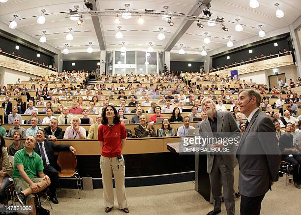 ATLAS experiment spokesperson Fabiola Gianotti European Organization for Nuclear Research DirectorGeneral RolfDieter Heuer and CERN spokesman Joe...