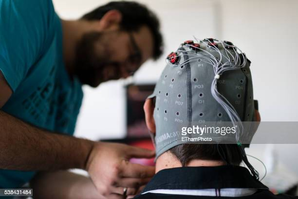 experiment with brain-computer interface (bci) in neuroscience laboratory - bci stock pictures, royalty-free photos & images