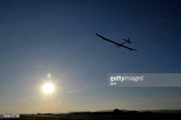 Experimental aircraft Solar Impulse takes off with pilot Andre Borschberg onboard from Payerne's Swiss airbase on July 7 2010 on the first attempt to...
