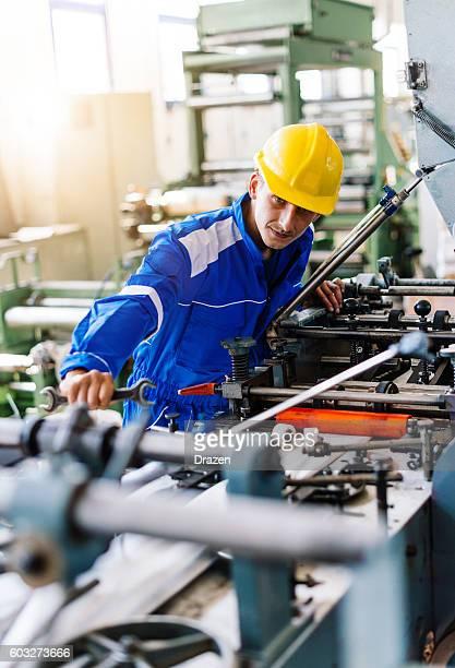 Expert engineeer examines malfunctions on machine