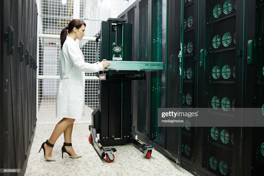Expert of cryptocurrency storage server working with hardware : Stock Photo