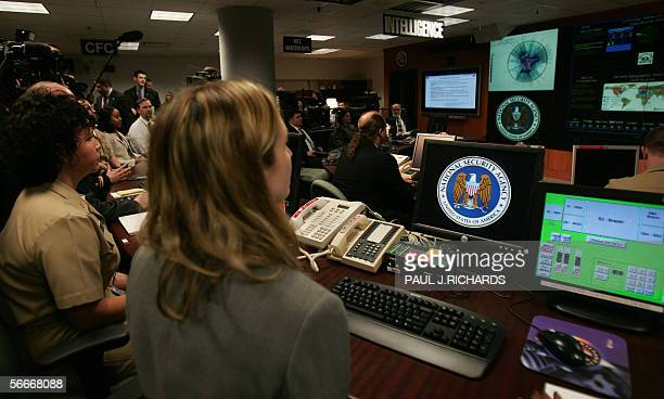 Experts man their stations at the Threat Operations Center inside the National Security Agency 25 January 2006 in suburban Fort Mead Maryland US...