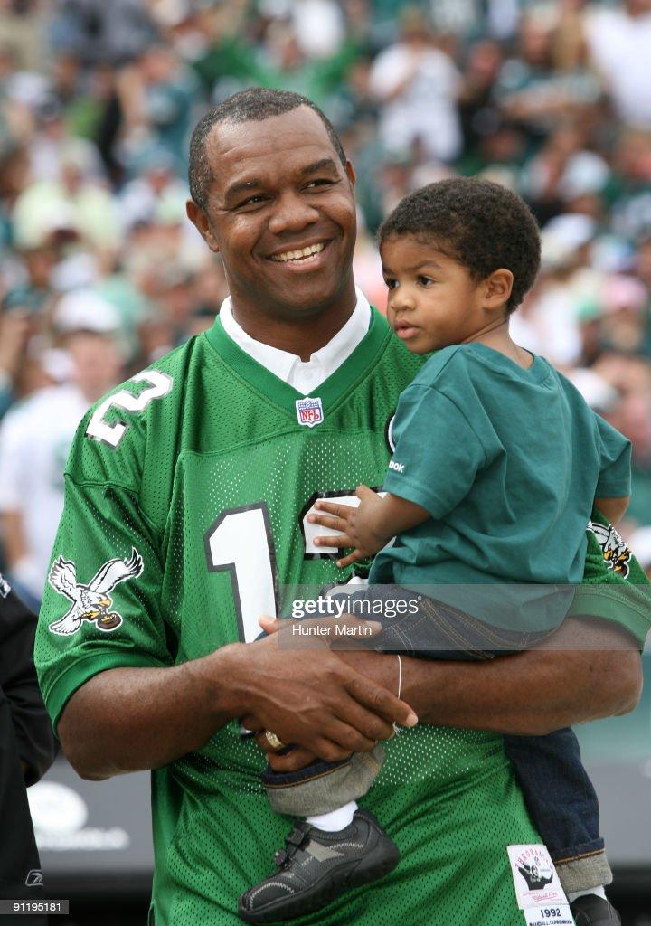 5154934b3ae Ex-Philadelphia Eagles quarterback Randall Cunningham holds his son ...