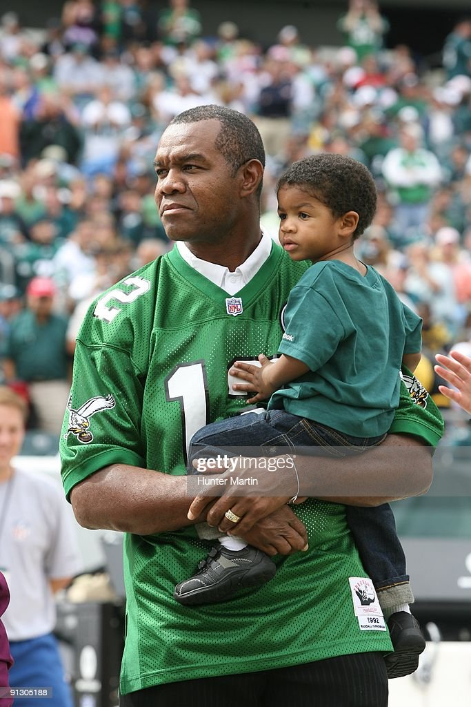3f02d9482e5 Ex-Philadelphia Eagles quarterback Randell Cunningham holds his son ...