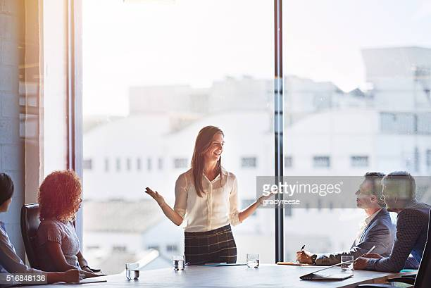 explaing her ideas in detail - brilliant stock photos and pictures