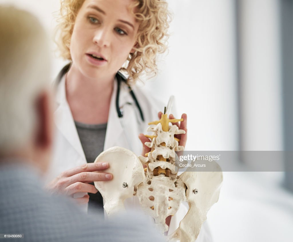 Explaining his condition in detail : Stock Photo