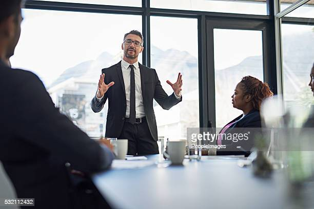 explaining his vision in detail - gesturing stock pictures, royalty-free photos & images