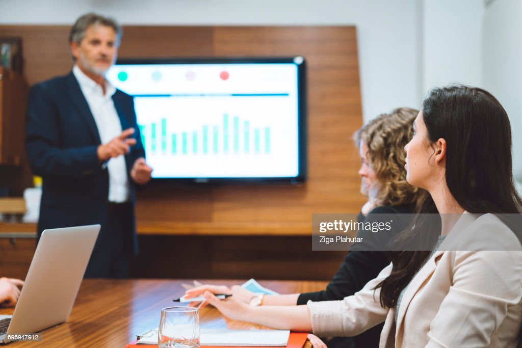 Explaining the finer points of business : Stock Photo