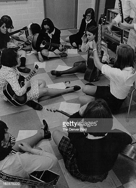 MAY 6 1969 'Explo '69' at St Mary's Pat Wander in dark stockings a 16yearold junior at St Mary's Academy explains the proper chording to students...