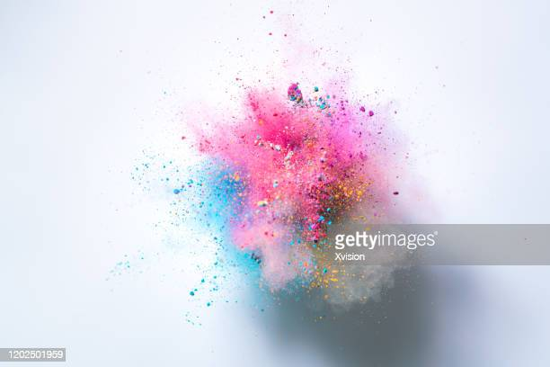 explode powder with white background captured with high speed sync. - farbklecks stock-fotos und bilder
