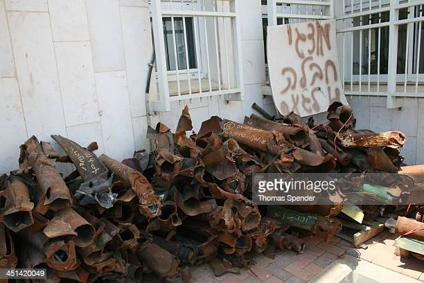 Exploded qassam rockets fired at the southern Israeli town of Sderot from the Gaza Strip are piled up behind a building.