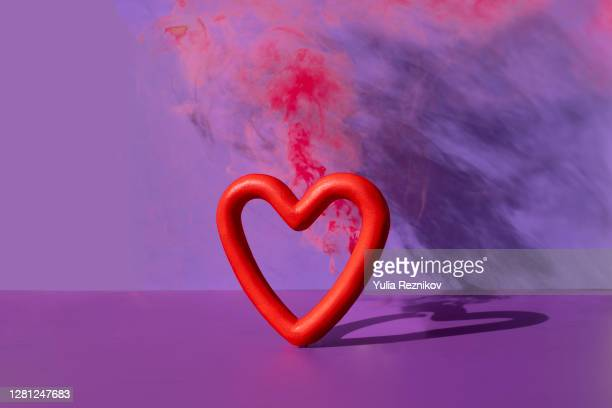 exploding heart shape on the purple background - relationship difficulties stock pictures, royalty-free photos & images