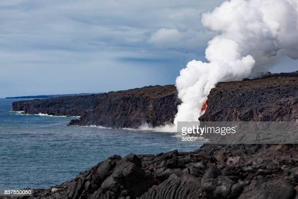 exploding lava flow into the ocean, big island, hawaii islands - big island hawaii islands stock pictures, royalty-free photos & images