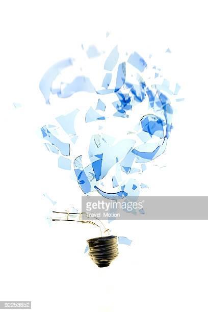 Exploding light bulb on a white background