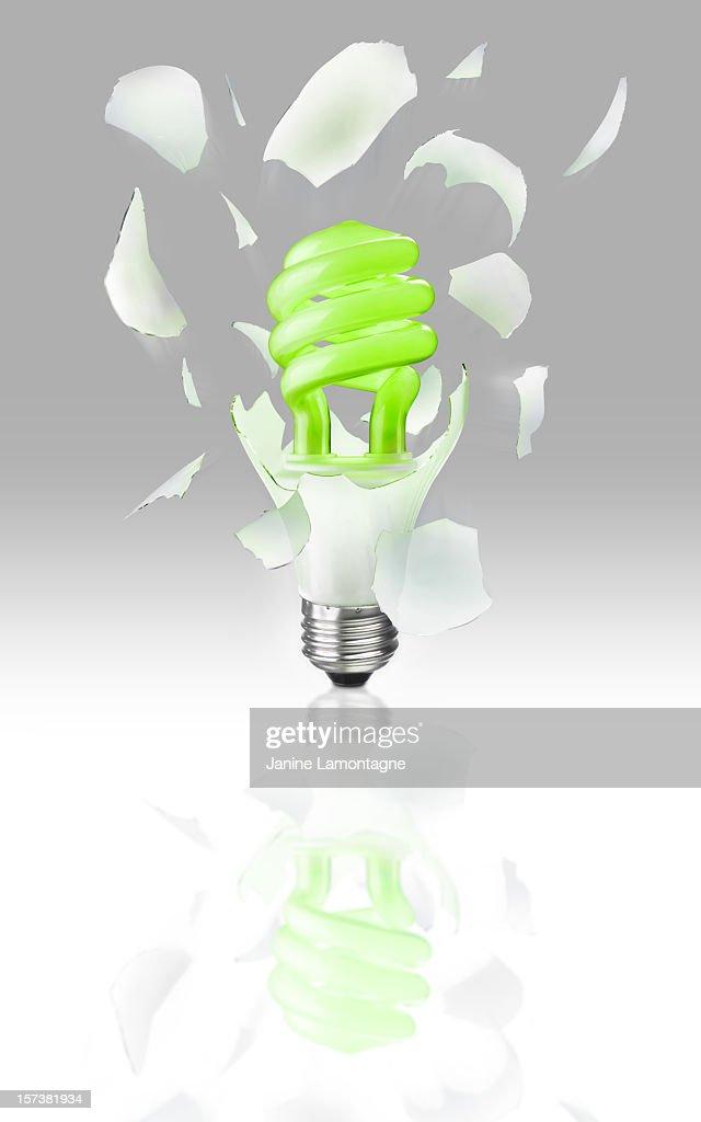 Exploding Light Bulb on gray : Stock Photo