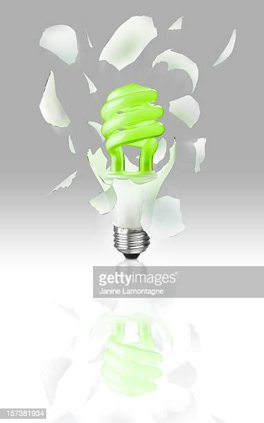exploding light bulb on gray - janine gray stock pictures, royalty-free photos & images