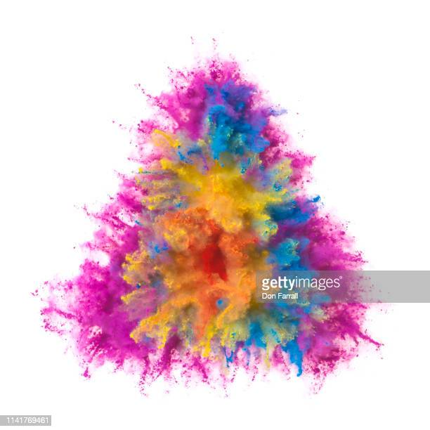 exploding multi colored powder in the shape of a triangle - don farrall stock pictures, royalty-free photos & images