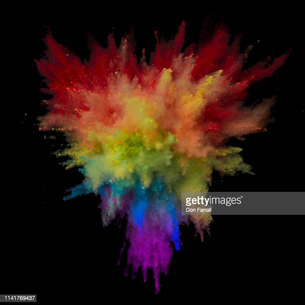 exploding multi colored powder in triangle shape - don farrall stock pictures, royalty-free photos & images