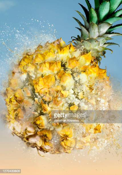 exploding pineapple - pops of bright color stock pictures, royalty-free photos & images