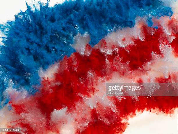 exploding red, white and blue colored powder - independence day stock pictures, royalty-free photos & images