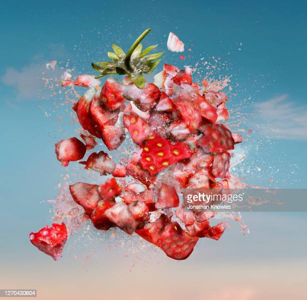 exploding strawberry - exploding stock pictures, royalty-free photos & images