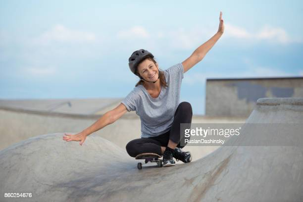 explore young at heart. senior woman skateboarding. - spread wings stock pictures, royalty-free photos & images