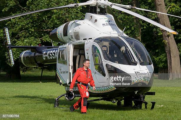 Explorer helicopter doctor crew from the Kent Surrey Sussex Air Ambulance Trust on the ground in Ruskin Park after emergency flight to Kings College...