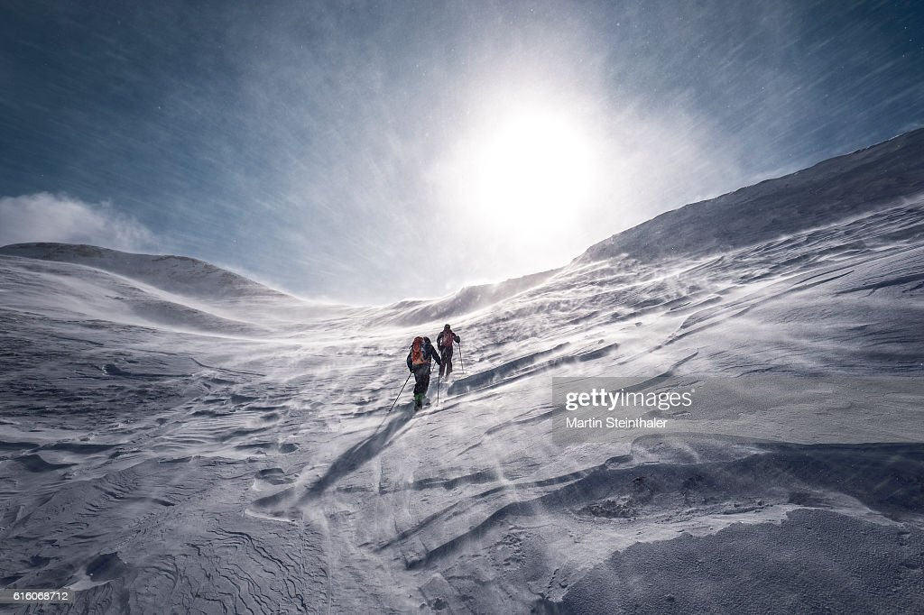 Explorer on skiing tour with icy snowstorm : Stock Photo