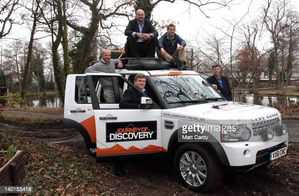 Explorers Ben Saunders Monty Halls Bear Grylls Ray Mears and Sir Ranulph Fiennes pose for a photograph beside the 1000th Land Rover Discovery in the...