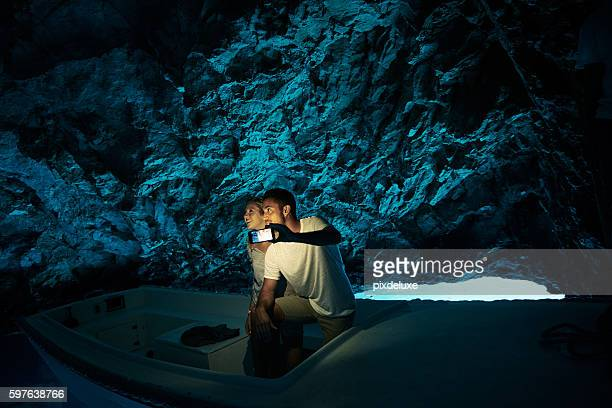 Exploring a cave on the water