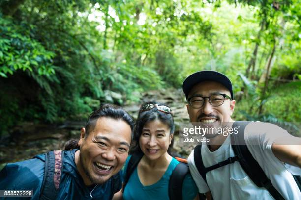 exploring a forest in okinawa japan - tdub_video stock pictures, royalty-free photos & images