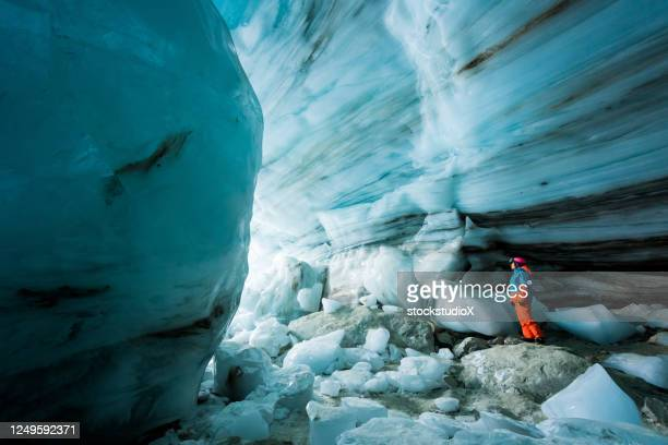 exploring an ancient glacial ice cave - whistler british columbia stock pictures, royalty-free photos & images