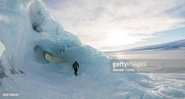 Exploring an iceberg frozen into the surface of the McMurdo Sound in the Ross Sea Region of Antarctica.