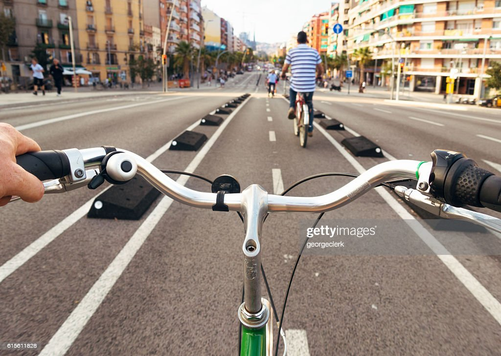 Exploring Barcelona by bicycle - cyclist point of view : Stock Photo