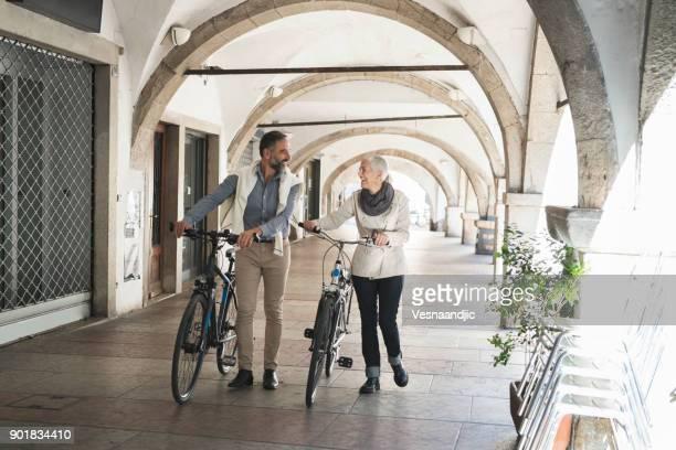 exploring city with bicycle - trento foto e immagini stock