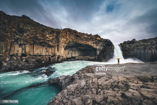 exploring icelandic wilderness - waterfall stock pictures, royalty-free photos & images