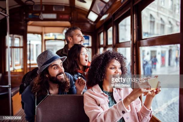 exploring in a tram - toerisme stockfoto's en -beelden