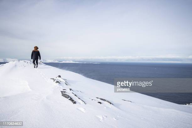 exploring the arctic: hiking on the ice of nordkapp - northern europe stock pictures, royalty-free photos & images