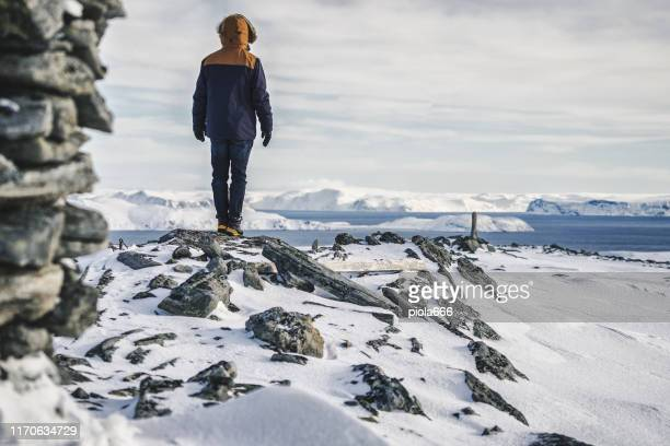 exploring the arctic: hiking on the ice of nordkapp - northern norway stock pictures, royalty-free photos & images