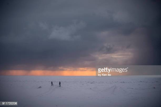 exploring the frozen lake at sunset - ken ilio stock pictures, royalty-free photos & images